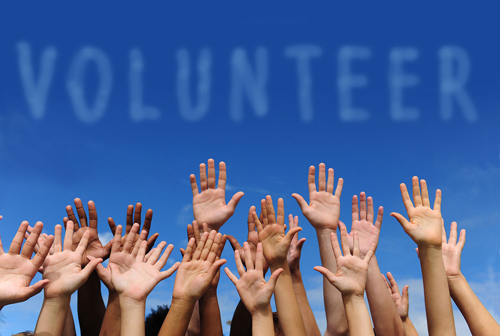 Volunteer-Hands-Raised